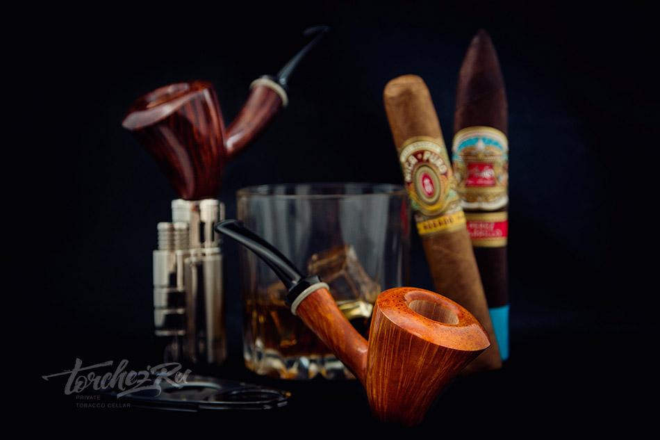 Курительные трубки и сигары на фотографии